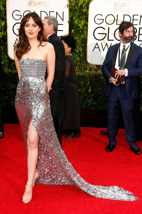 All eyes fixate on Johnson's amazing gams in this Chanel Haute Couture number that just so happens to be in a fitting shade of gray at the 72nd Annual Golden Globe Awards.