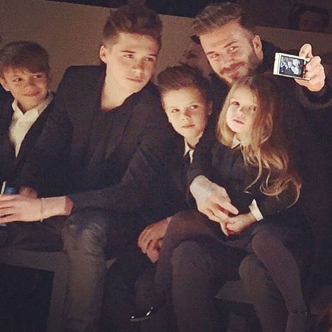 """The Ridiculously Adorable Family Affair"" FRow-defining moment: David Beckham brought his whole brood to cheer on mom, and documented the occasion with a selfie. Seen above:  Romeo Beckham, Brooklyn Beckham, Cruz Beckham, David Beckham, Harper Beckham"