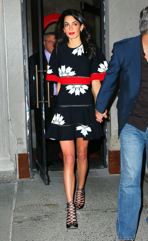 In an Alexander McQueen dress while out for dinner with her parents, sister, and George Clooney at New York City's Caravaggio.