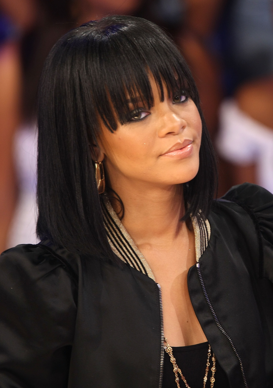 Strange Rihanna39S Best Beauty Looks Rihanna Beauty Evolution Short Hairstyles Gunalazisus