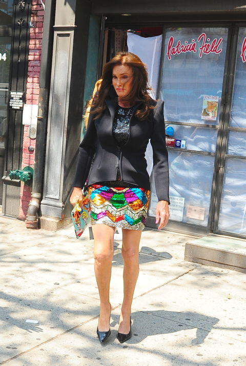 Wearing a rainbow mini skirt, sequined top, and blazer while leaving the Patricia Field store in New York City.