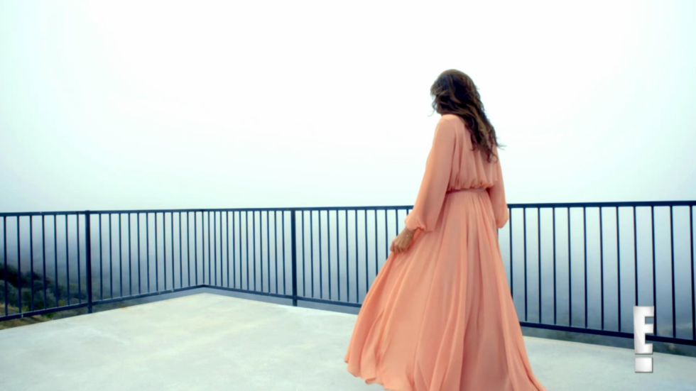 In a pink chiffon dress in the second I Am Cait promo.