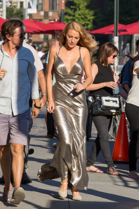 In a silver dress while filming Woody Allen's new period film in New York City.
