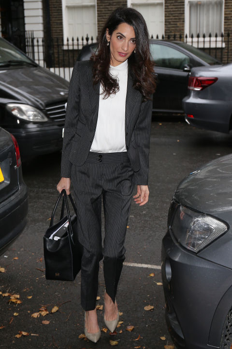 Arriving at Doughty Street Chambers in London in a Dolce & Gabbana suit. </p><p>