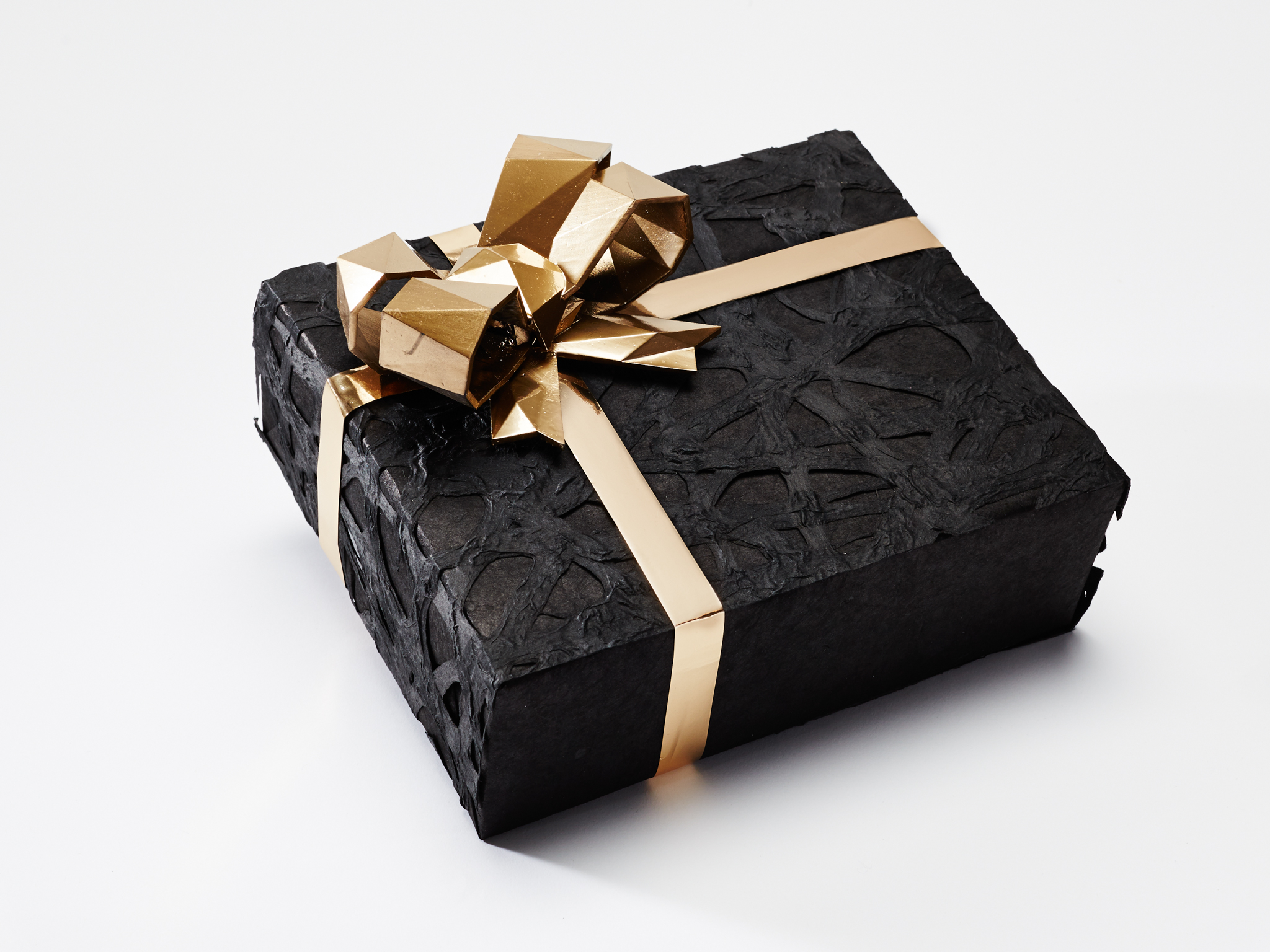 How 13 designers gift wrap holiday presents for How to wrap presents with wrapping paper