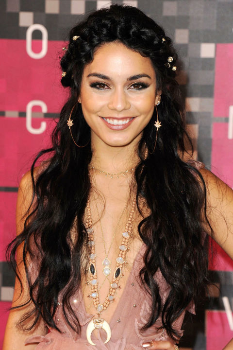 A bohemian at heart, Hudgens accents her beloved braid crowns with belly-button-length waves.