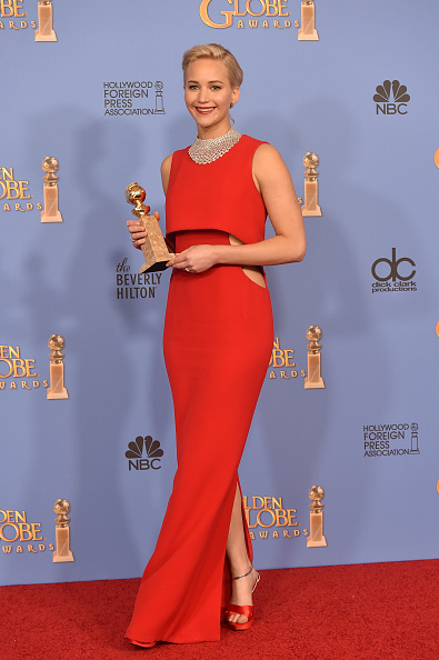 In a red Dior gown posing with her award for Best Actress at the 73rd Annual Golden Globe Awards in Beverly Hills, California.