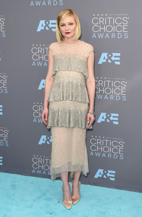 In Chanel Couture dress and Roger Vivier shoes with Ferragamo clutch and Fred Leighton jewelry.