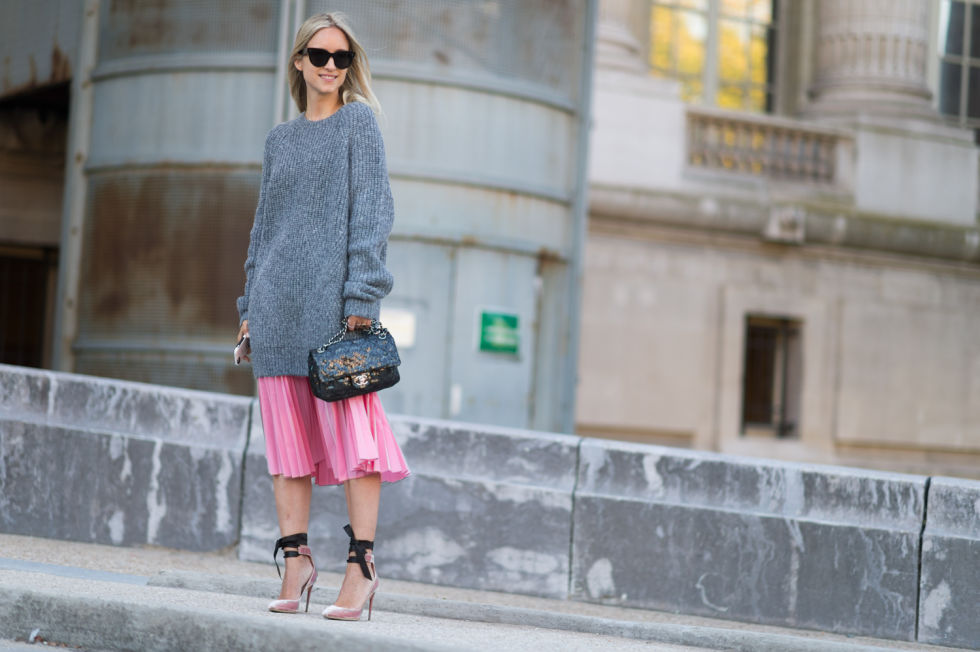 Take a chance on new silhouettes and pair an oversized sweater with a midi skirt to create a faux dropped waistline. A pair of high heels keeps the outfit from looking too dowdy.