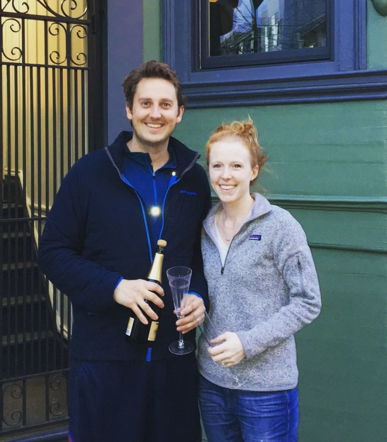 Laura Turner and her husband in front of their house