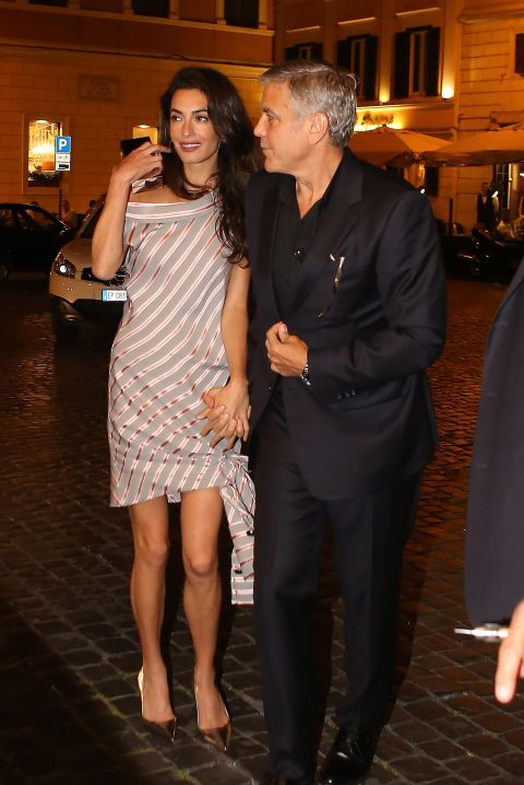 In a Monse dress with Jimmy Choo clutch and shoes while out to dinner in Rome with George Clooney.