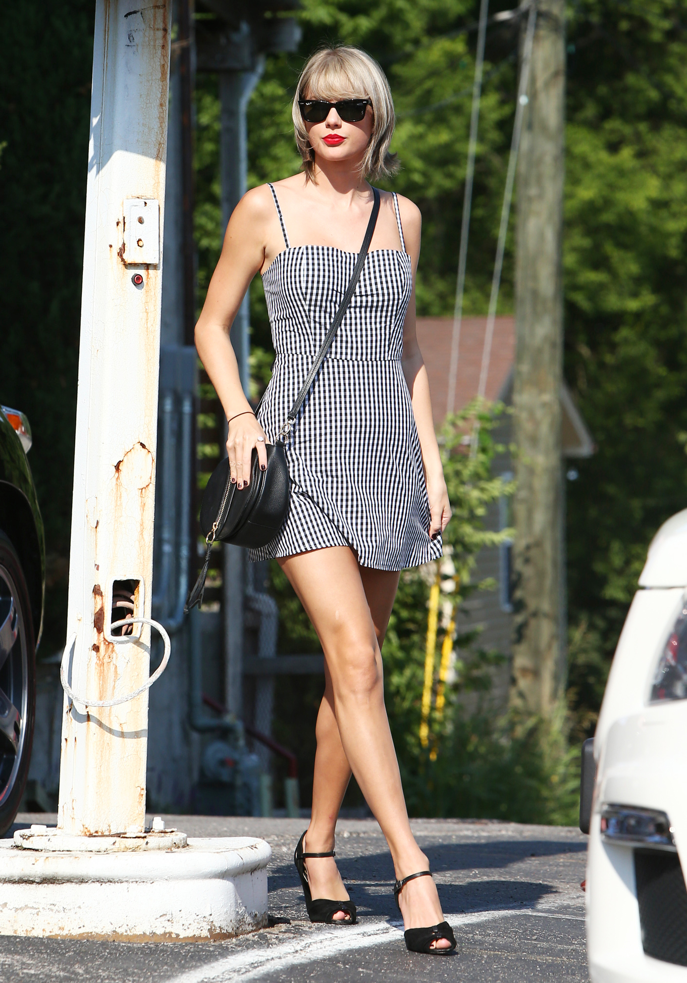 Taylor Swift in Black Bandeau and Leather Skirt - Fashion and ...