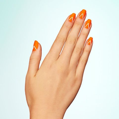 Start with a neon orange base, then add an inverted-V to each nail. Once dry, set the look with a matte topcoat. Design by @paintboxnails