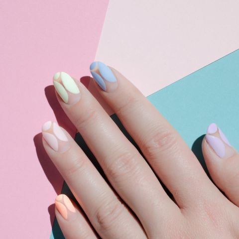 On the opposite side of the color spectrum is the matte pastel, seen here in a negative nail design.Design by @palemoonseattle