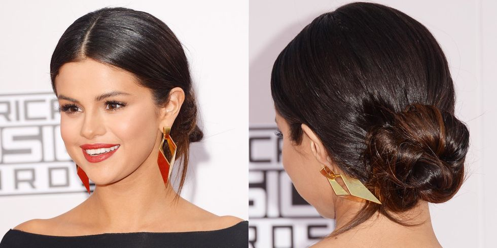 To attend the 2014 American Music Awards, she chose a low bun with her hair parted in the middle.