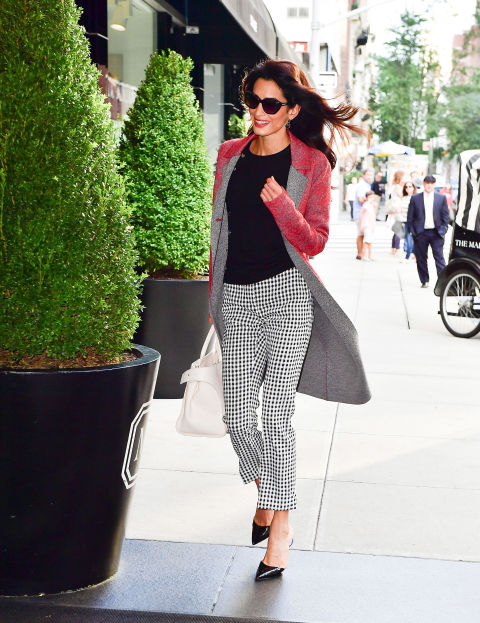 Out in New York City, Amal Clooney wore Altuzarra's Neville Coat, Minamoto Side-Button Sweater, and Harley Gingham Pant from the Pre-Spring 2017 Collection.