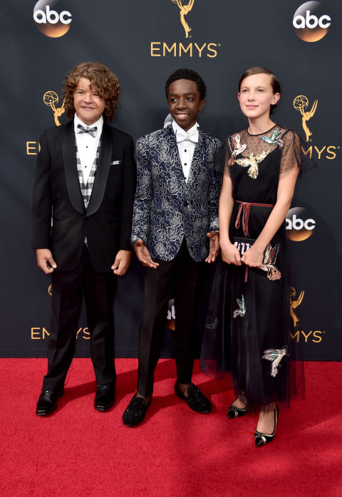 Millie Bobby Brown in aRed Valentino gown and Edie Parker clutch.