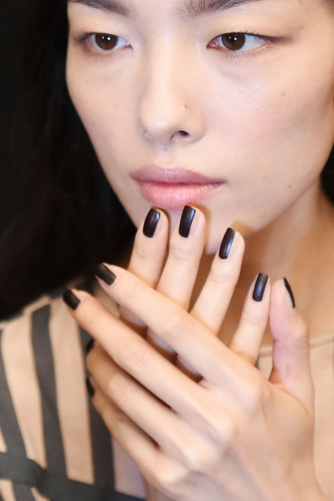 Nail Artist Jin Soon Choi created two striped nails for Vera Wang. For this dark look, JINsoon Audacity was applied in a centered strip, then finished with a matte top coat.