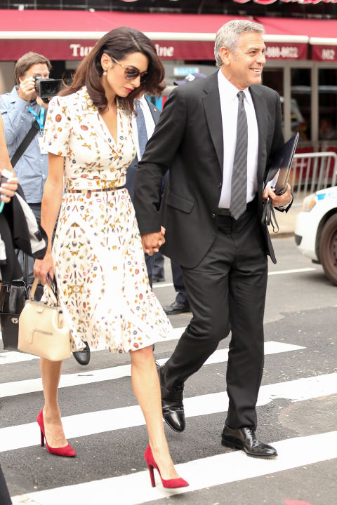 Out in New York City with George Clooney, wearing the same print Kate Middleton did at Wimbledon.