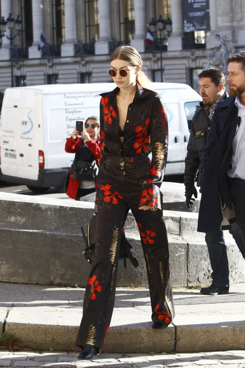Wearing a Jenny Packham shirt and pants with a Versace backpack during Paris Fashion Week.