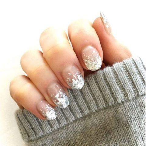 Sometimes a touch of sparkle is all you need. Try this silver-dipped look by applying glitter polish to your tips, and gradually fading it into a bare half moon. Design by @naominailsnyc