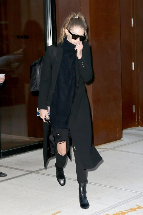 Out in New York City wearing a black coat by Smythe, 7 For All Mankind jeans, and Sandro ankle boots.