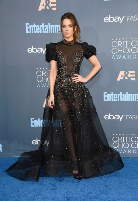 In Reem Acra dress, Christian Louboutin heels and Mimi So jewelry.
