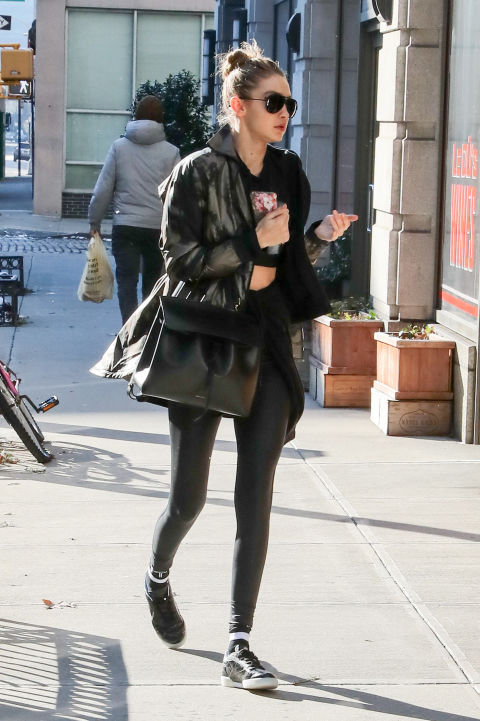 Out in NYC in black leggings and a black coat.