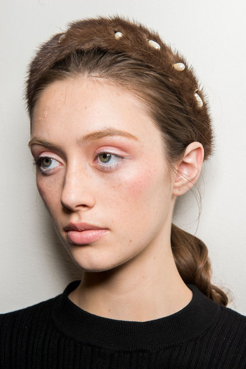 The vibe:Girl With aPearl Earring,theiconic painting by Johannes Vermeer. Get the look:Lead makeup artist Tom Pecheux used pink blush all over the eyelids, lips,and cheekbones to give models an extra-youthful look. The kit: M.A.C Into the Pink Blush