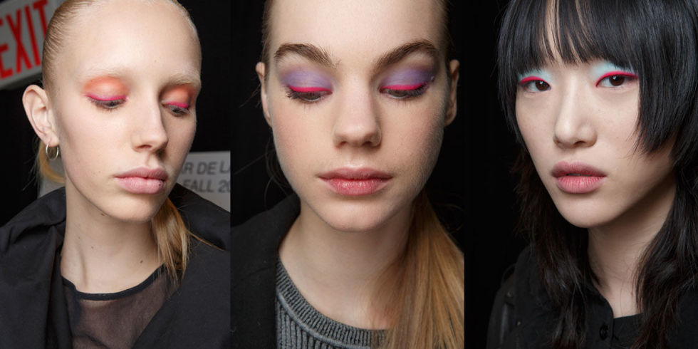 """The vibe:Bold Get the look: Using M.A.C products, lead makeup artist Tom Pecheaux created a two-toneeyeinspired by """"happiness,"""" he said. Eyes were lined with a neon pink and lids were either cyan, purple, or orange. The kit: M.A.C Chromacakes"""