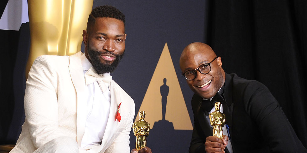 Screenwriter Tarell Alvin McCraney (L) and writer/director Barry Jenkins, winners of Best Adapted Screenplay for 'Moonlight',