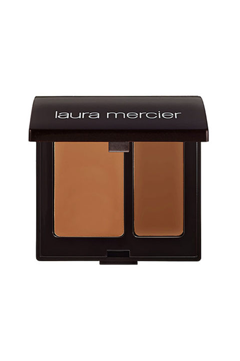 This all-time pro fave letsyou color match to your skin by mixing the dual-shade concealer. It's called camouflage because it can disguise seriously dark circles and bright red blemishes without piling it on. $35, lauramercier.com