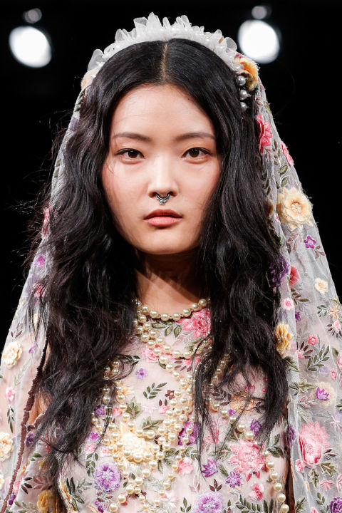 Contrast a traditional veil like those seen at Naeem Khan with lowkey, beach waves.