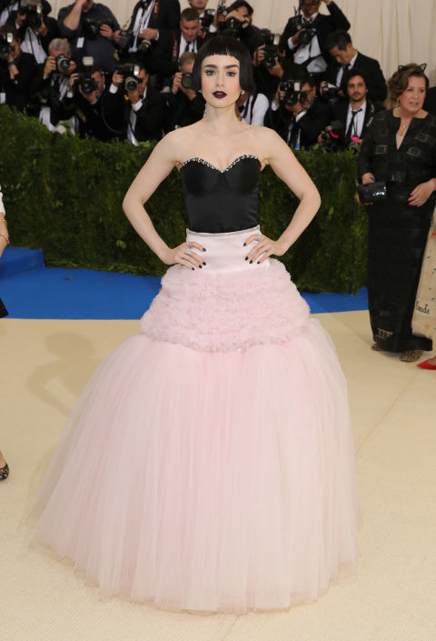 In Giambattista Valli couture.