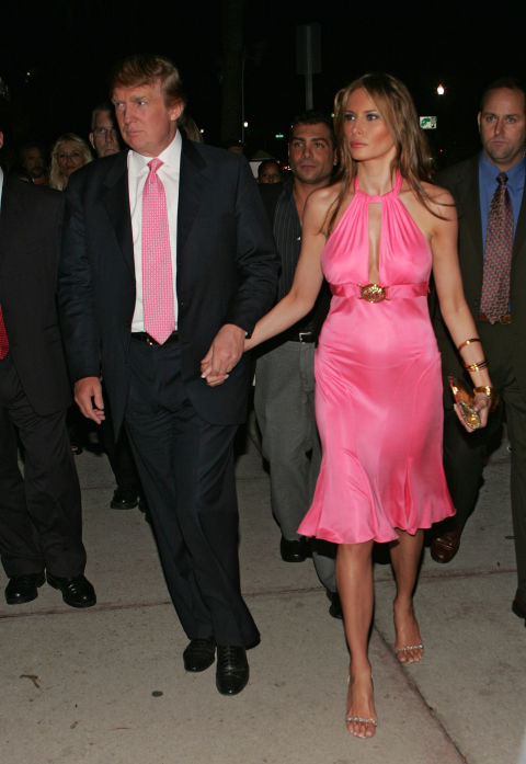 Donald Trump and Melania Trump make their way on Ocean Drive to Casa Casuarina on March 4, 2005 in Miami Beach, Florida