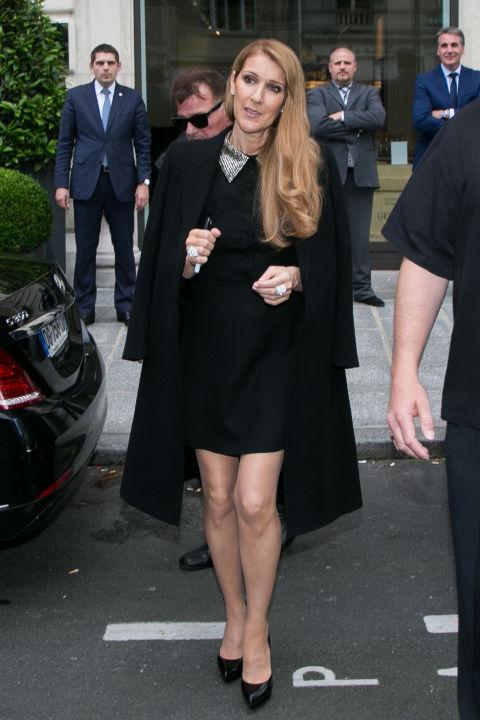 Out in Paris, wearing a Saint Laurent dress.