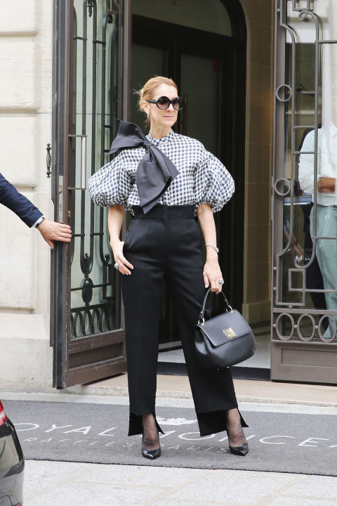 Wearing a Dice Kayek blouse, Celine pants, and Celine Dion collection bag while out in Paris.