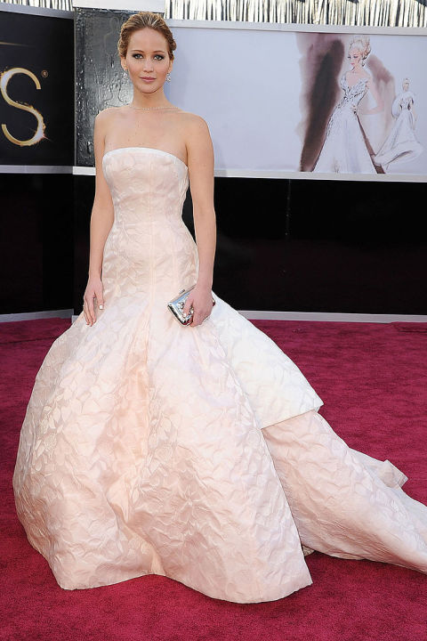 Lawrence looked stunning at the 2013 Oscars in a Dior Couture blush ball gown. She tripped while ascending the stairs to receive her award for Best Actress for her role in Silver Linings Playbook. She joked in an interview,