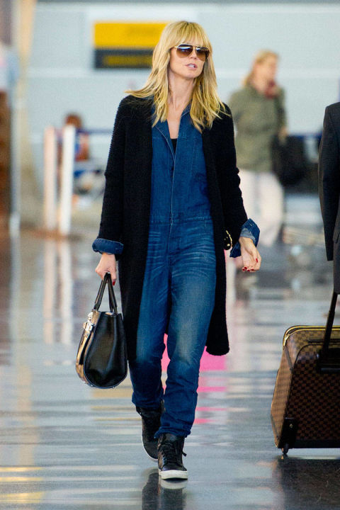 A denim jumpsuit is a jet-setter's dream—chic and comfy.