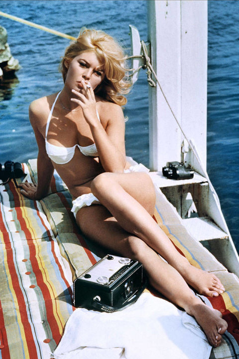 Brigitte Bardot is often credited with popularizing the bikini first by wearing the look in her 1952 film, The Girl in a Bikini, and then by wearing it a year later in Cannes, where paparazzi photographed her sunbathing in a strapless two-piece. But it is this white underwire top and ruffled bottom from Louis Malle's New Wave film that truly makes waves for us.
