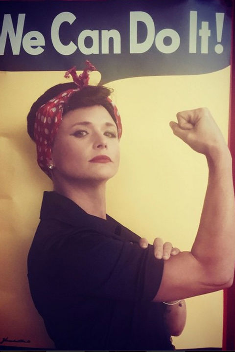 As Rosie the Riveter.