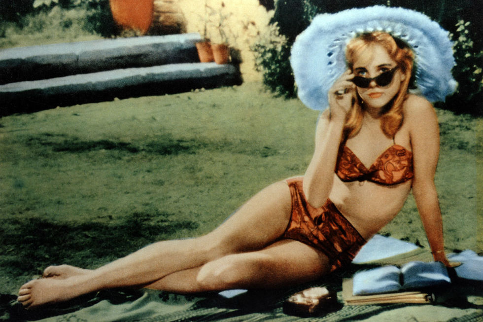 Close to 800 girls auditioned for the brazen role of Lolita Haze, but it was former model Sue Lyon who ended up getting the part and creating film history in this scene in which she first meets her older lover in a tropical print hipster bikini, wide-brimmed hat, and cat-eye—not heart-shaped—sunglasses.