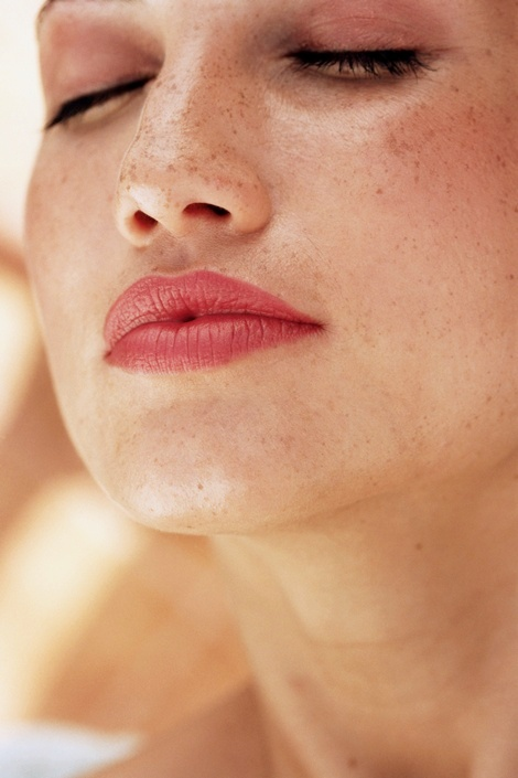 "The Problem: Uneven Skin Tone   While increased sun exposure can cause fair-skinned faces to freckle, darker complexions are also vulnerable: According to dermatologist Elizabeth Tanzi, MD, women of color are more likely to get uneven pigmentation. ""Once that blotchiness sets in, it's really difficult to treat,"" she says. The Solution:  Don't sunbathe. Even a slight tan represents injury to your dermis so keeping up with your sunscreen-slathering duties is a must; a formula with SPF 30 or higher should be reapplied every couple of hours. If the damage has already been done, invest in alpha-hydroxy acid peels. But consider yourself warned: Even though they'll reduce discoloration, peels will increase your skin's photosensitivity—making sun protection even more essential."