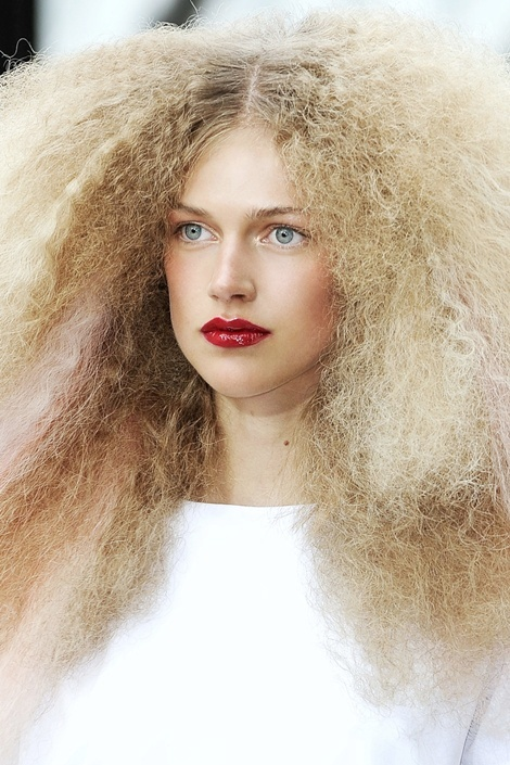 The Problem: Frizzy Hair   Depending on where you live, summer can mean hotter, more humid air—which can wreak havoc with defenseless, frizz-prone strands.  The Solution:  When styling, use a ceramic blow-dryer with a diffuser for fast, smooth results and less heat damage. Finish with a product that's specially formulated to repel moisture from the humid air (we like    L'Oréal EverSleek Frizz Taming Crème Serum).    Want more tress-smoothing tips and product suggestions?  Click here.