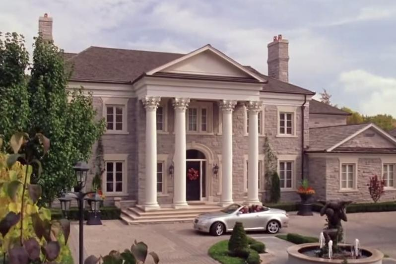 "What else would you expect from the most popular girl in school? Everything about this elaborate mansion screamed ""expensive,"" from the columns to the brick to the pricy convertible parked out front."