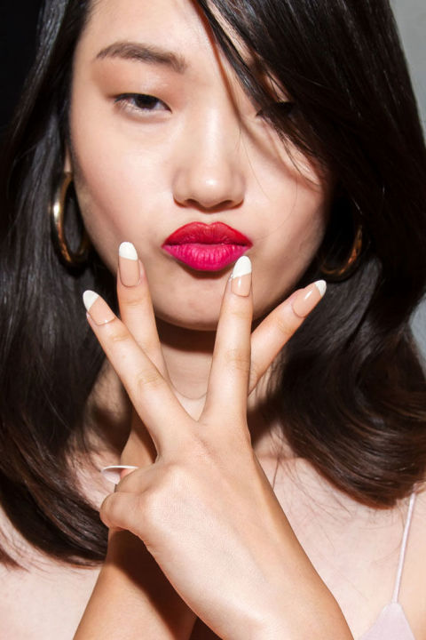 """Manicurist Alicia Torello created a manicure that""""was minimal yet high impact"""" on a sharp, stiletto shape. She contrasted two lacquers by Christian Louboutin:Just Nothing andSalonu."""